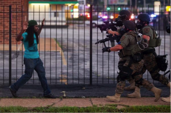 Troops in Ferguson Approaching a Young Man