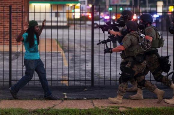 Troops in Ferguson Approaching a Young Man