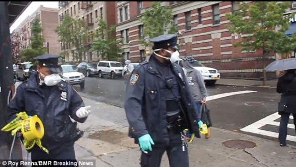 New York City Police Officers Taking Down Ebola Caution Tape