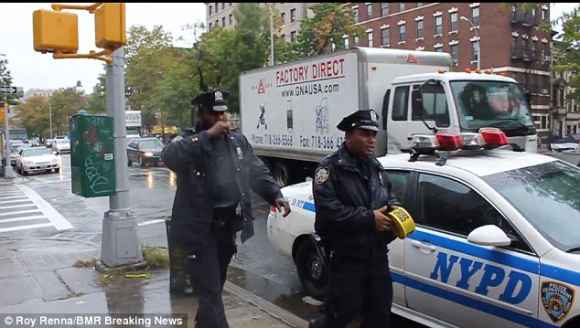 New York City Police Officer Touching His Mouth After Disposing of Ebola Related Materials
