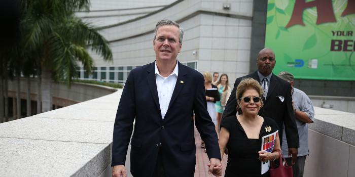 MIAMI, FL - JUNE 05: Former Florida Governor Jeb Bush and possible Republican presidential candidate walks with his wife, Columba Bush, as they arrive to present awards to the 2015 Arts for Life! scholarship winners at the Adrienne Arsht Center for the Performing Arts in Miami-Dade County on June 5, 2015 in Miami, Florida. Gov. Jeb Bush is expected to announce his plans to formally begin a run for the Republican presidential nomination on June 15th in Miami, Florida. (Photo by Joe Raedle/Getty Images)