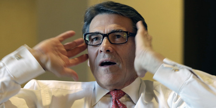 Texas Gov. Rick Perry is seen during an interview at the California Republican Party convention in Anaheim, Calif., Friday, Oct. 4, 2013. Perry compared the business environments of Texas and California, saying that excessive taxation, regulation and other factors were driving companies from California to other states, including Texas. (AP Photo/Reed Saxon)